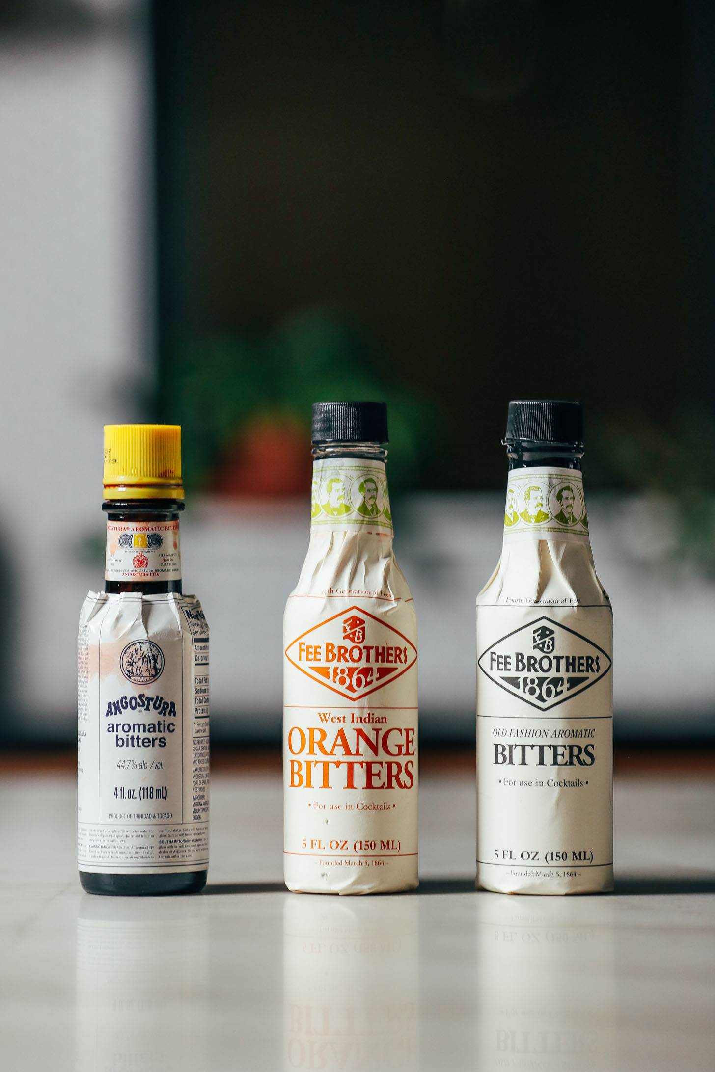 Three bottles of bitters for making an Old Fashioned