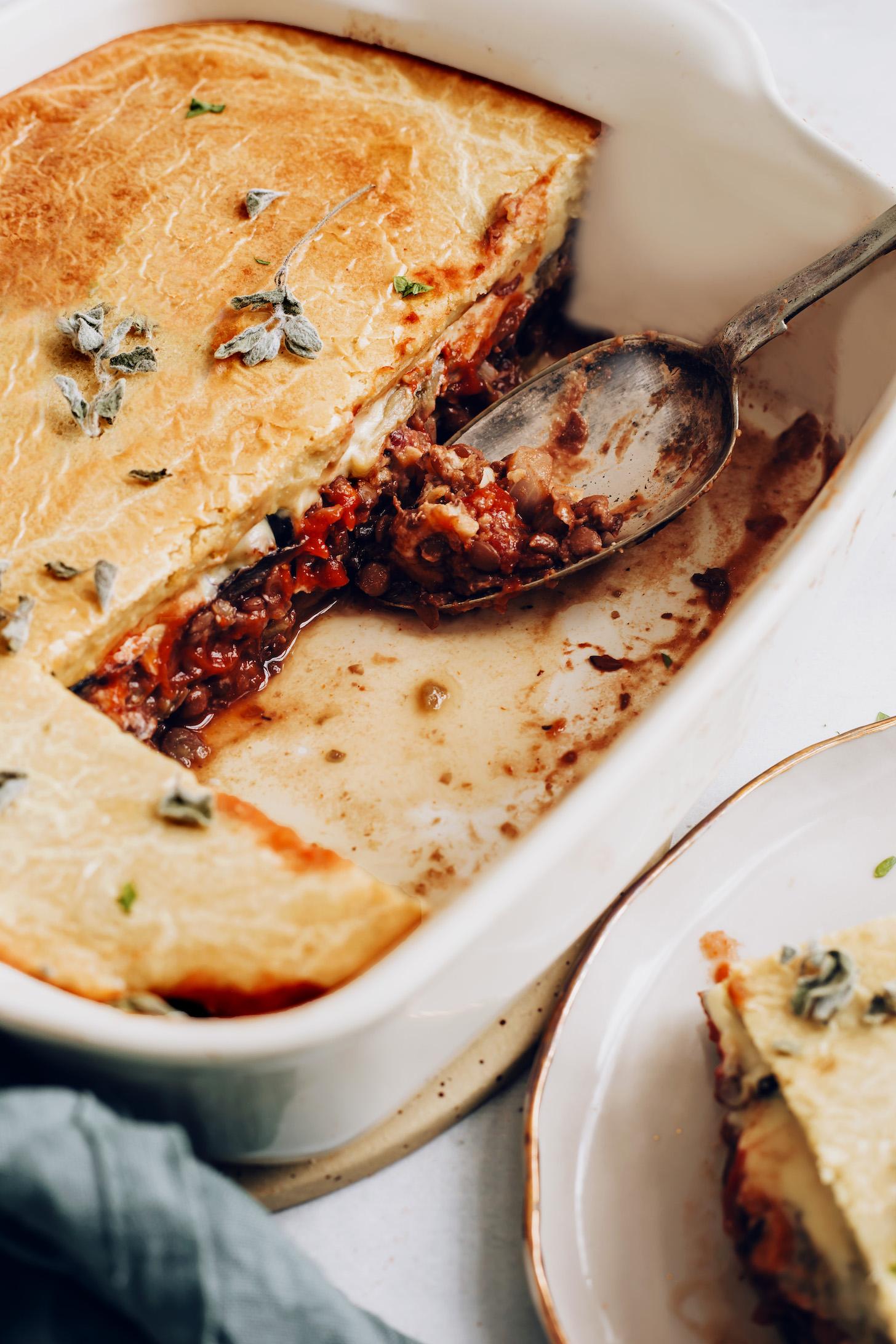 Vintage spoon in a pan of easy vegan moussaka