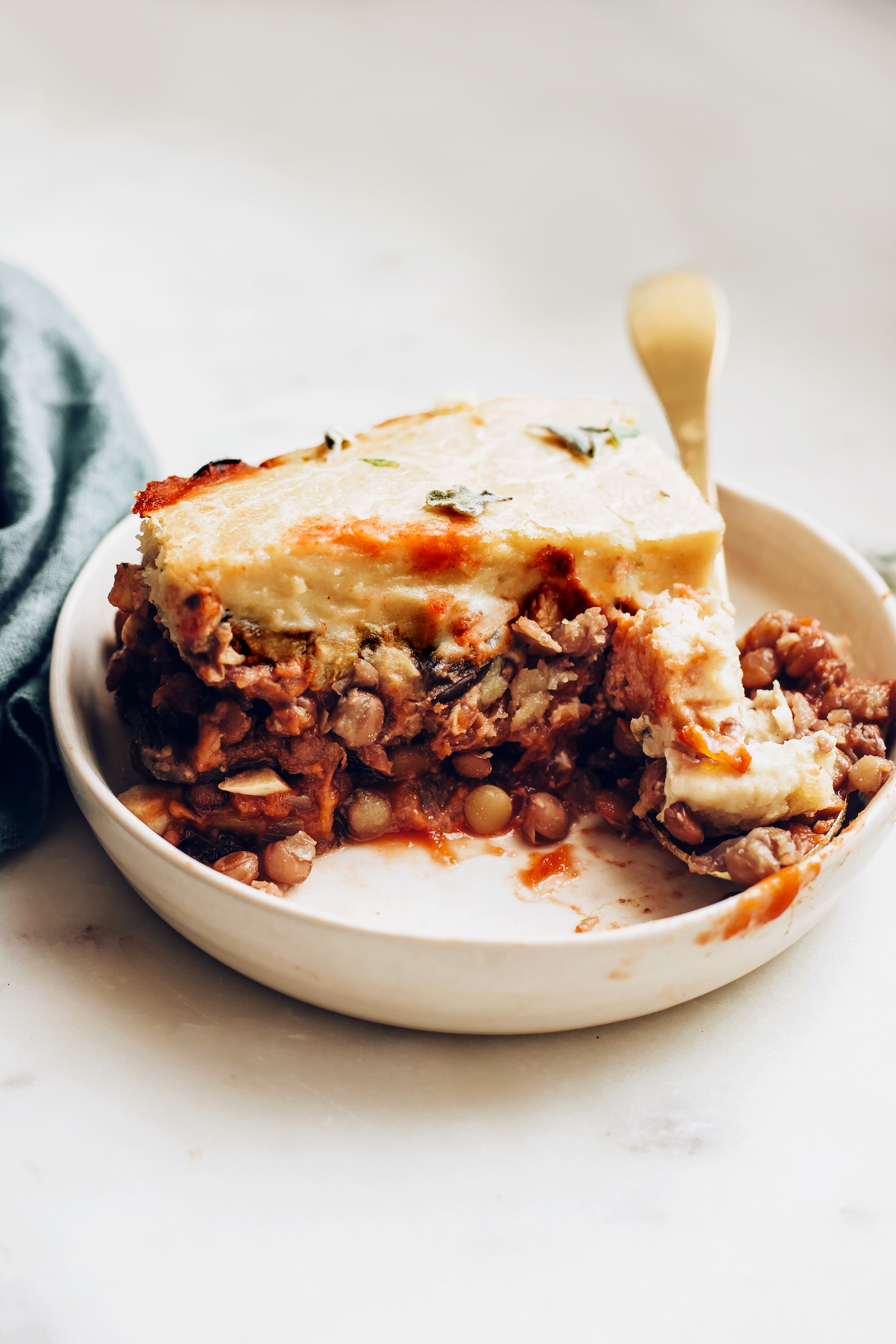 Vegan moussaka with a lentil base and cashew topping
