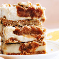 Plate stacked with three apple butter cheesecake bars