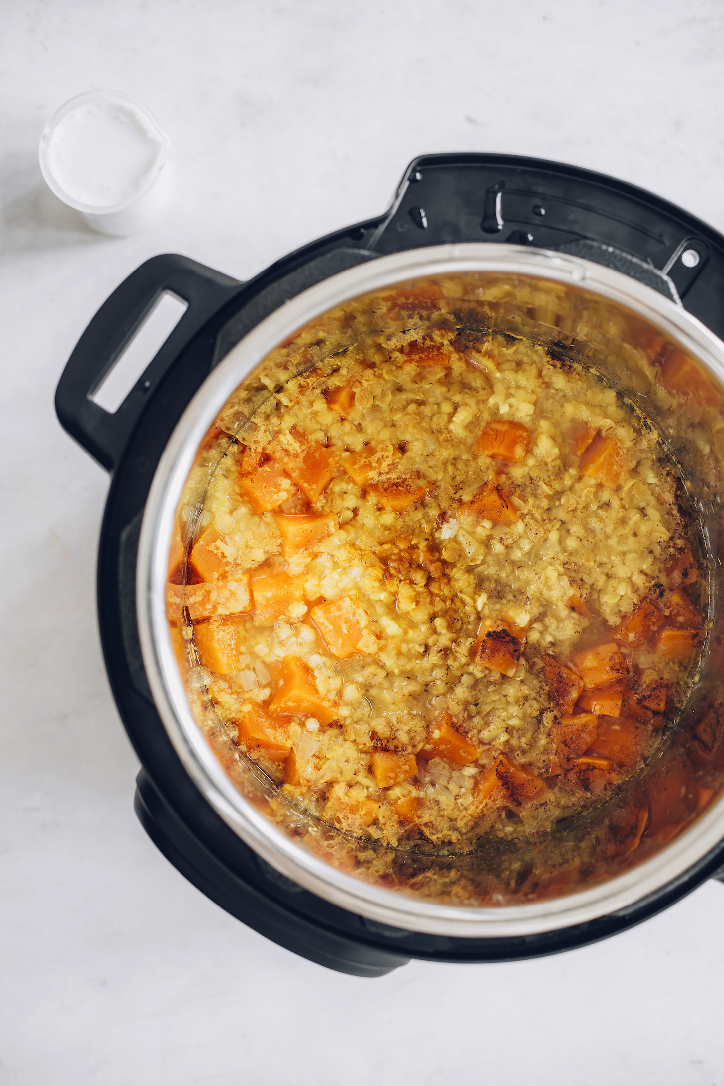 Cooked red lentils, sweet potato, and spices in an Instant Pot