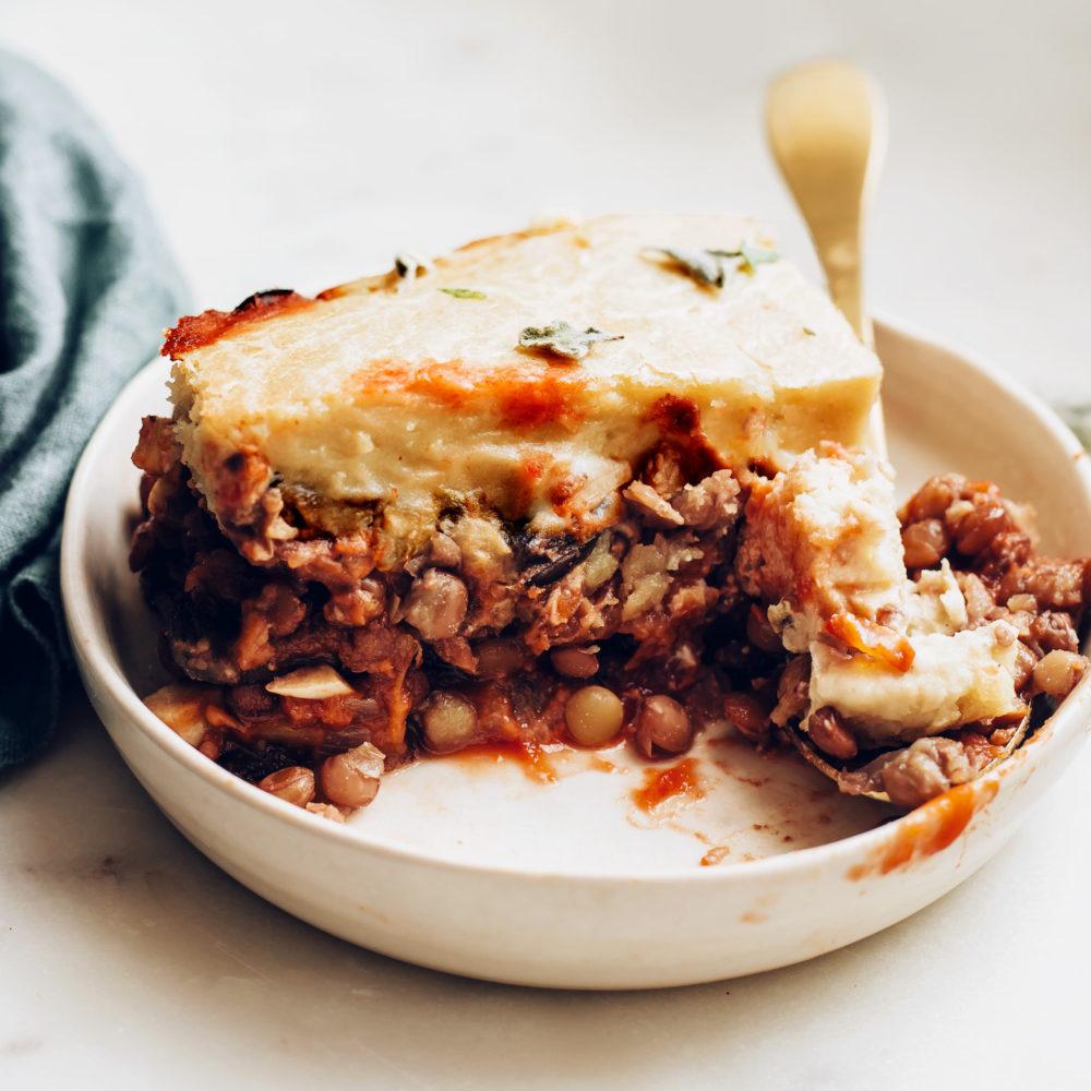 Fork resting on a plate of vegan moussaka
