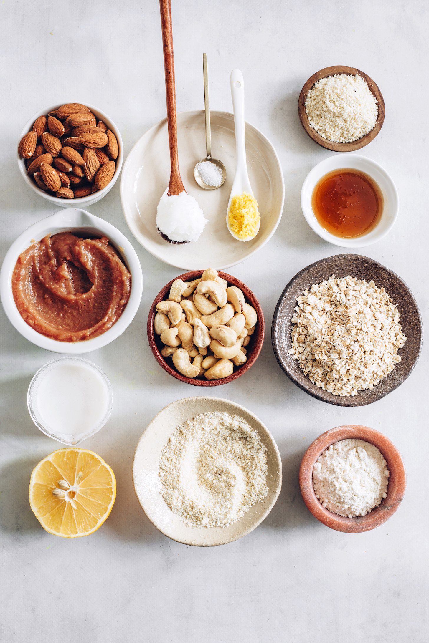 Almonds, apple butter, coconut cream, lemon, coconut oil, salt, cashews, almond flour, arrowroot starch, oats, and maple syrup
