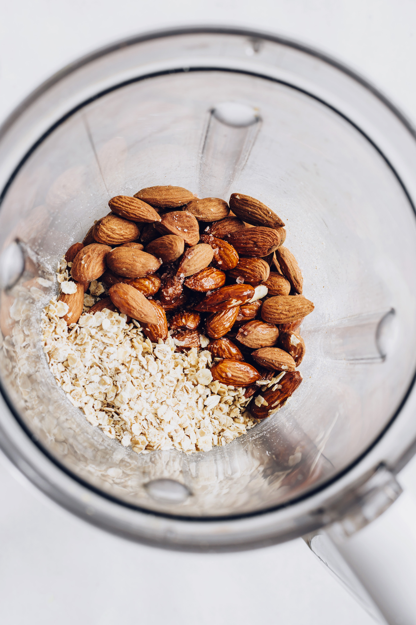 Blender with almonds, oats, sea salt, maple syrup, and coconut oil