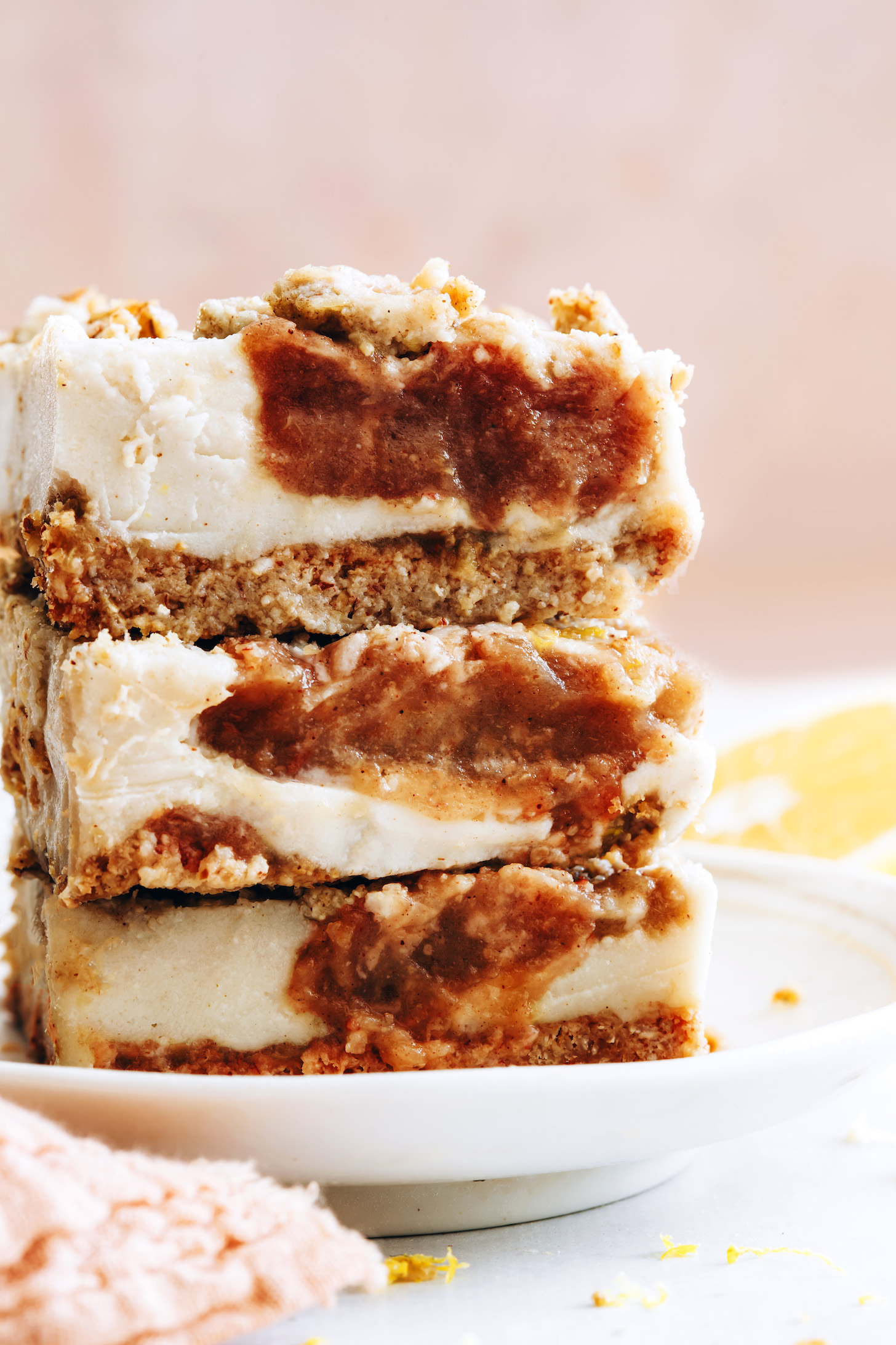 Close up shot of a stack of vegan cheesecake bars filled with apple butter