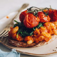 Roasted tomatoes, spinach, and baked beans on toast