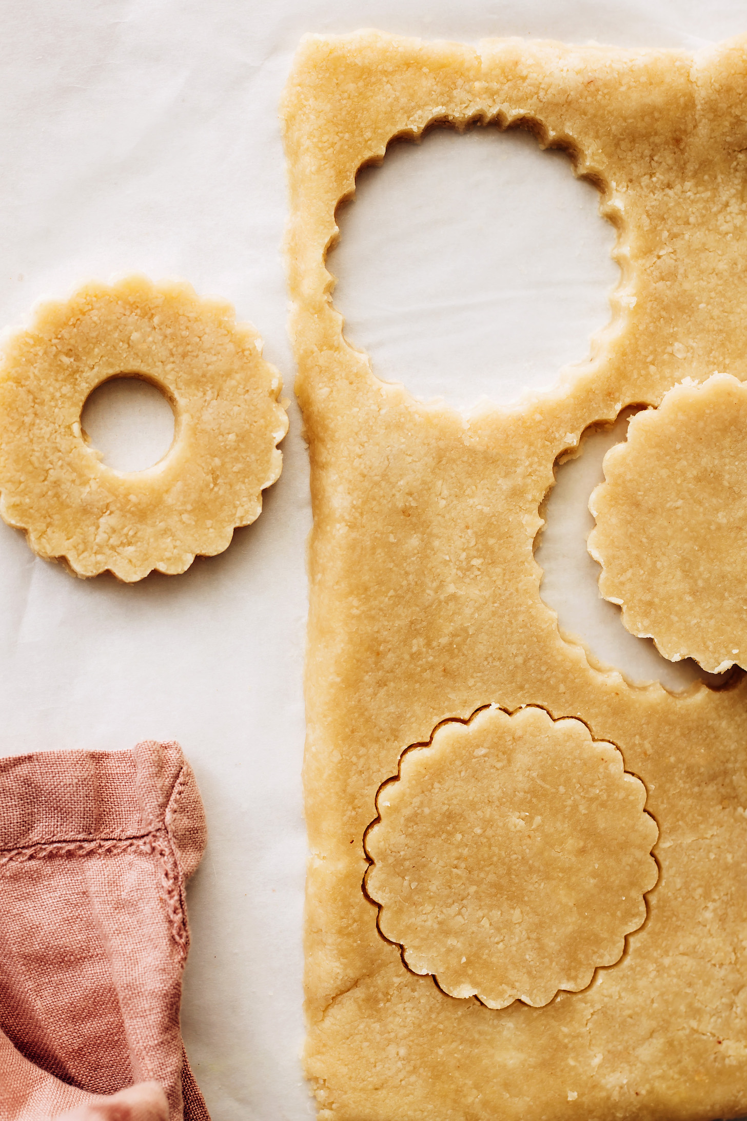 Rolled cookie dough cut with a cookie cutter