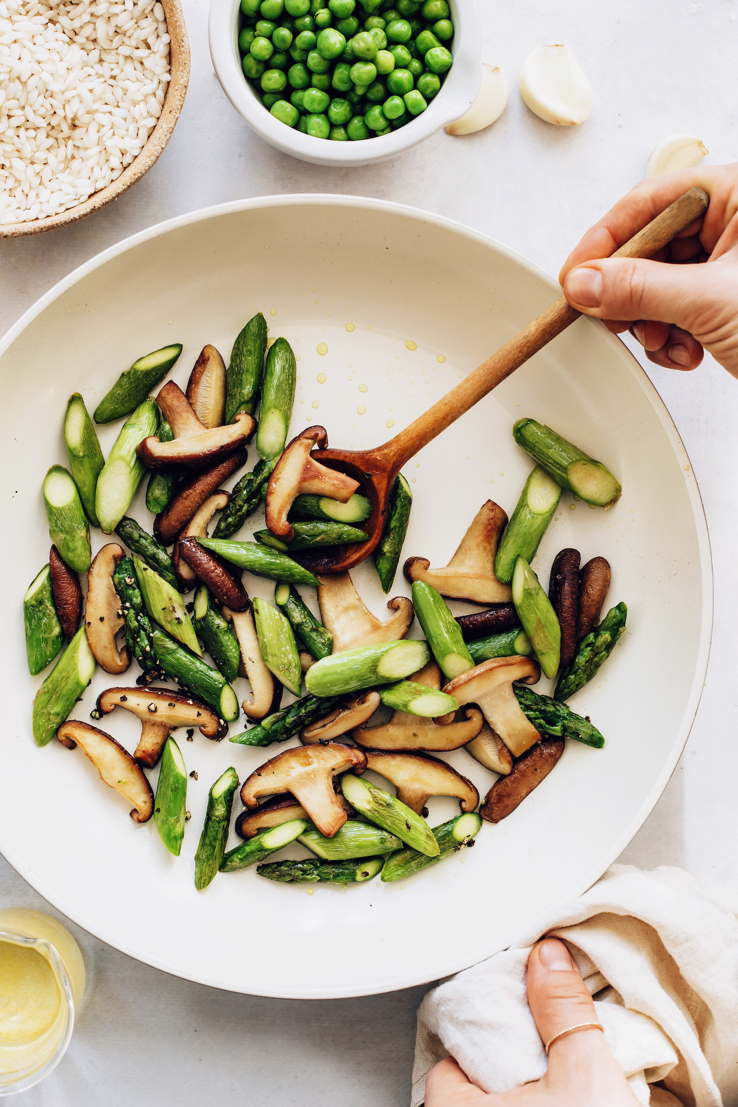Sautéing asparagus and mushrooms with salt and pepper