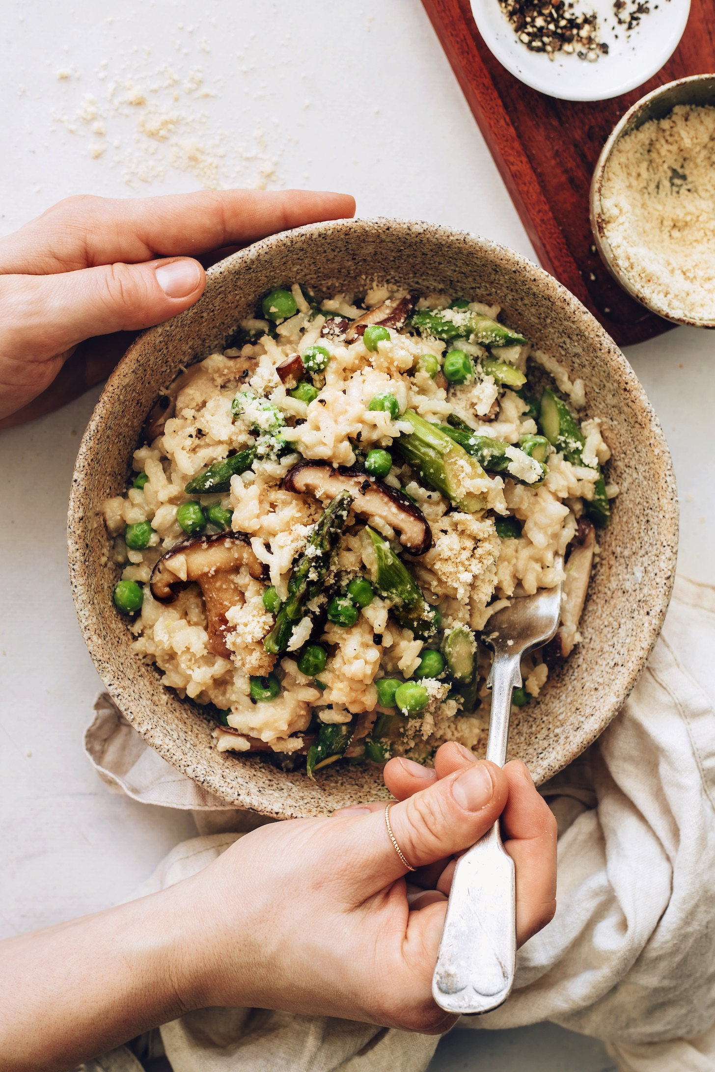 Bowl of spring vegetable risotto seasoned with vegan parmesan and miso