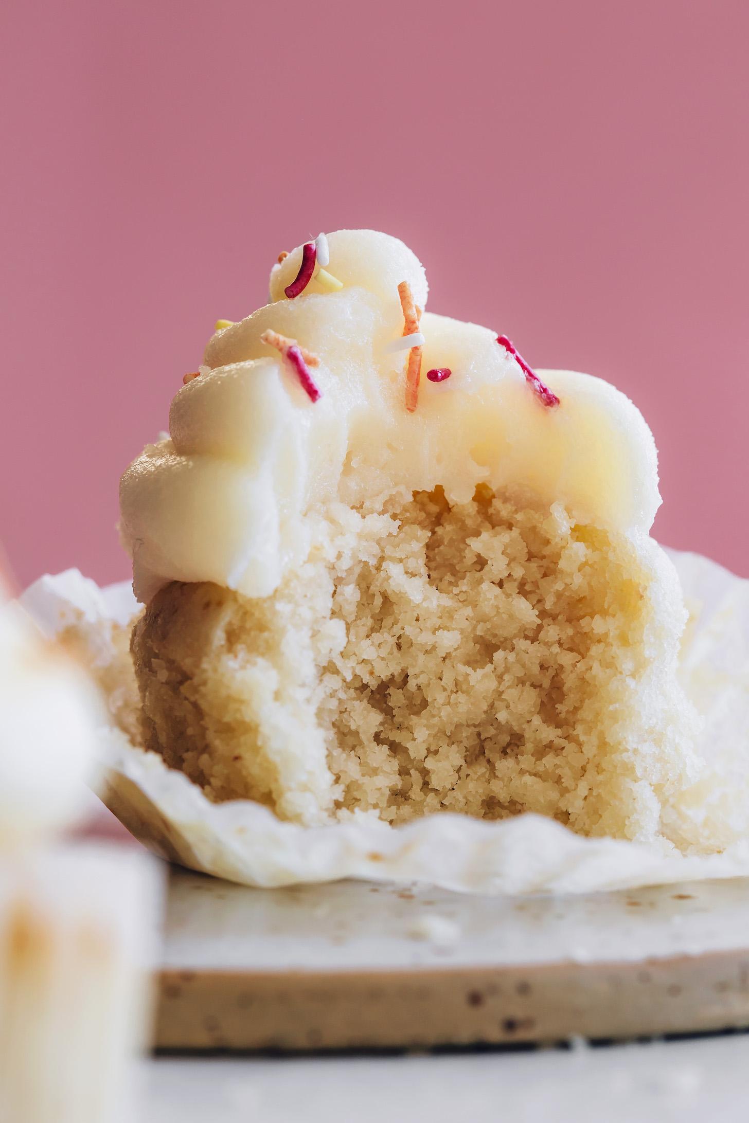 Partially eaten fluffy vegan vanilla cupcake