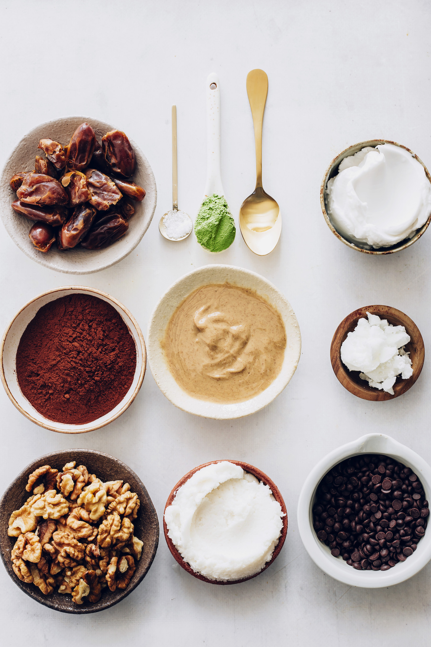 Dates, cocoa powder, walnuts, coconut butter, cashew butter, peppermint extract, coconut milk, coconut oil, moringa powder, salt, and chocolate chips