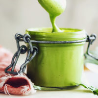Spoon and jar of green goddess dressing