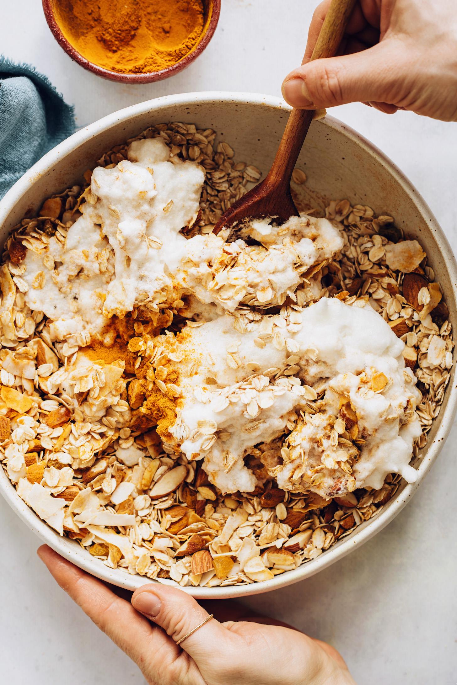 Stirring aquafaba with golden milk granola ingredients