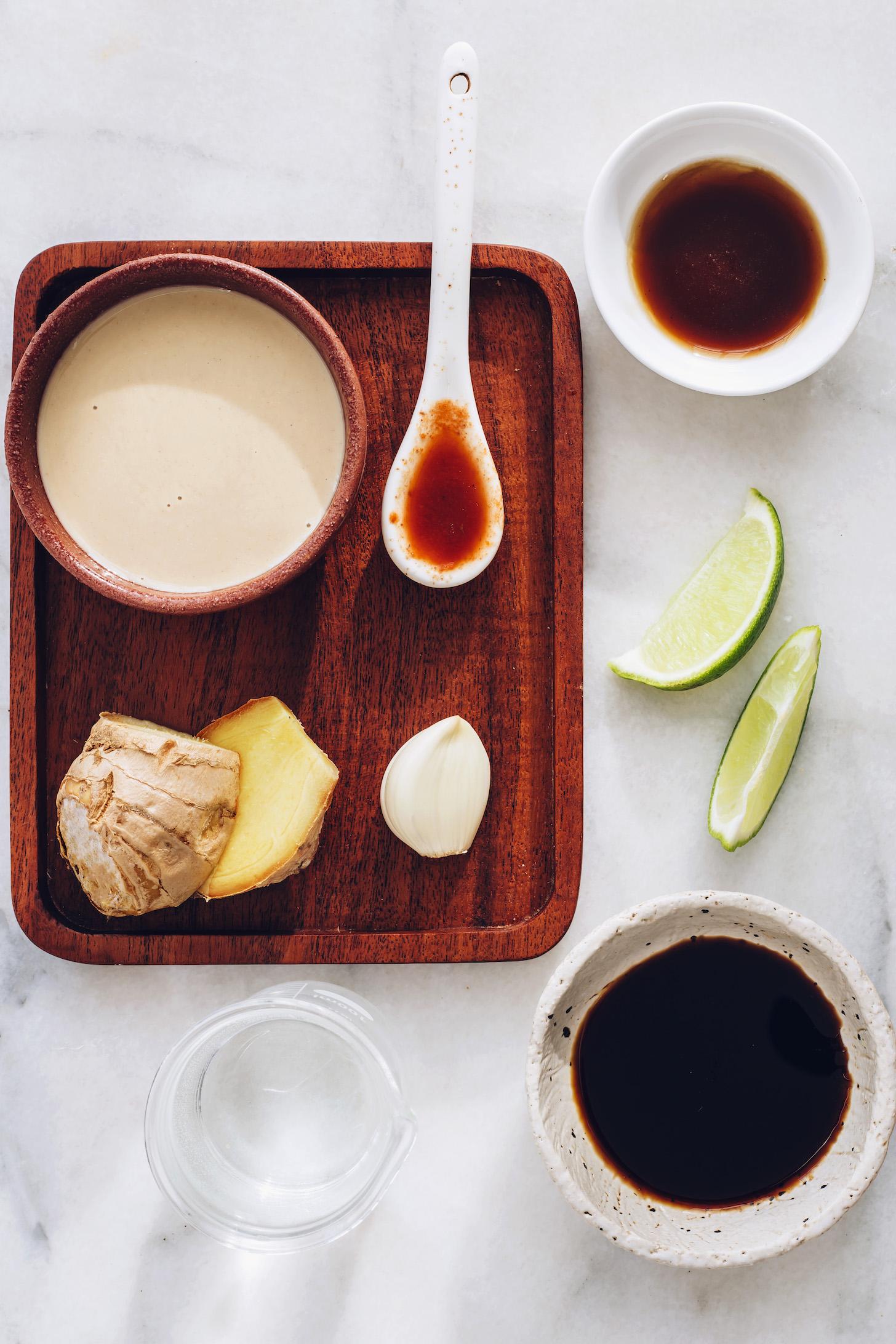 Tahini, ginger, garlic, chili garlic sauce, lime, maple syrup, tamari, and water