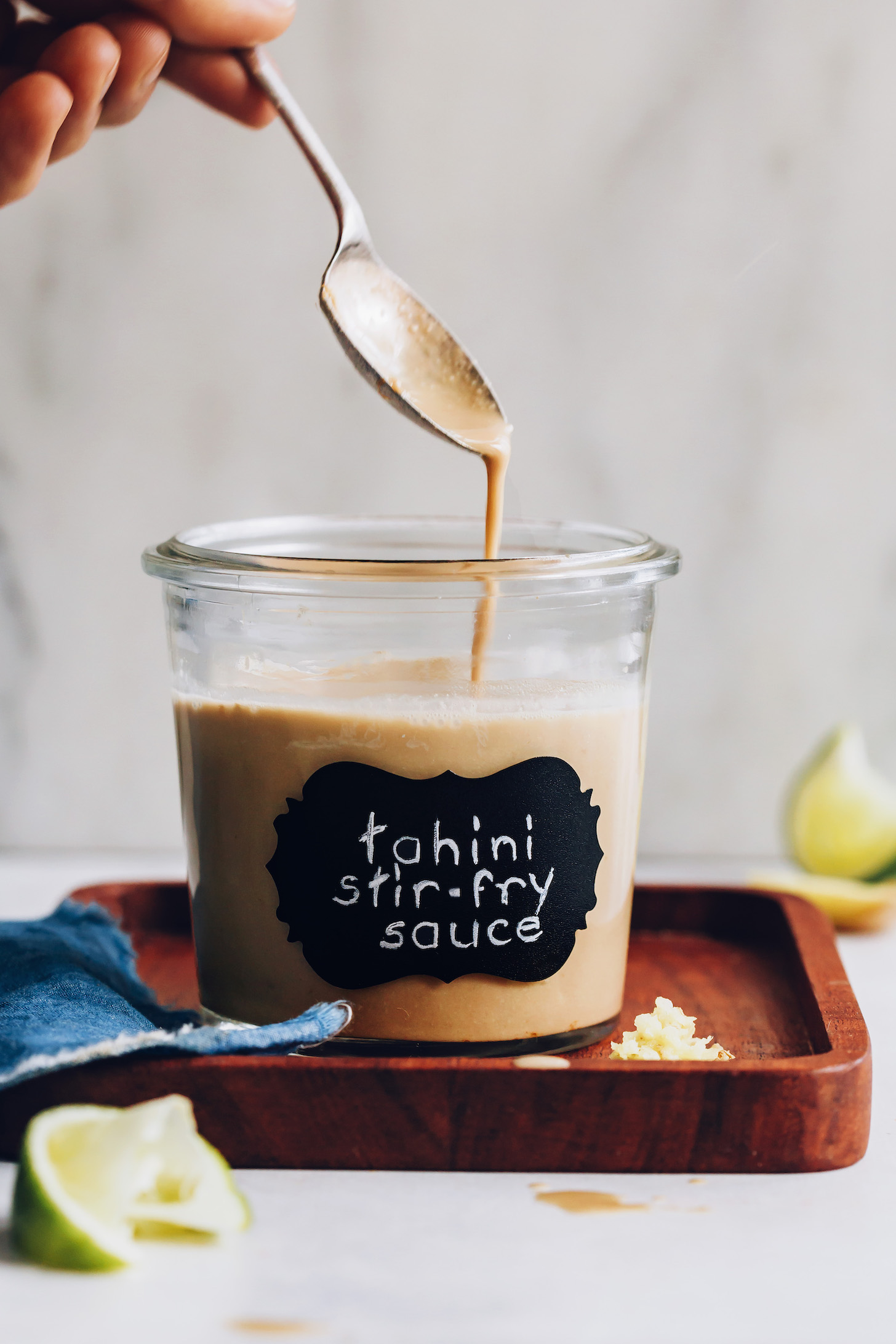 Jar and spoonful of our easy stir fry sauce made with tahini