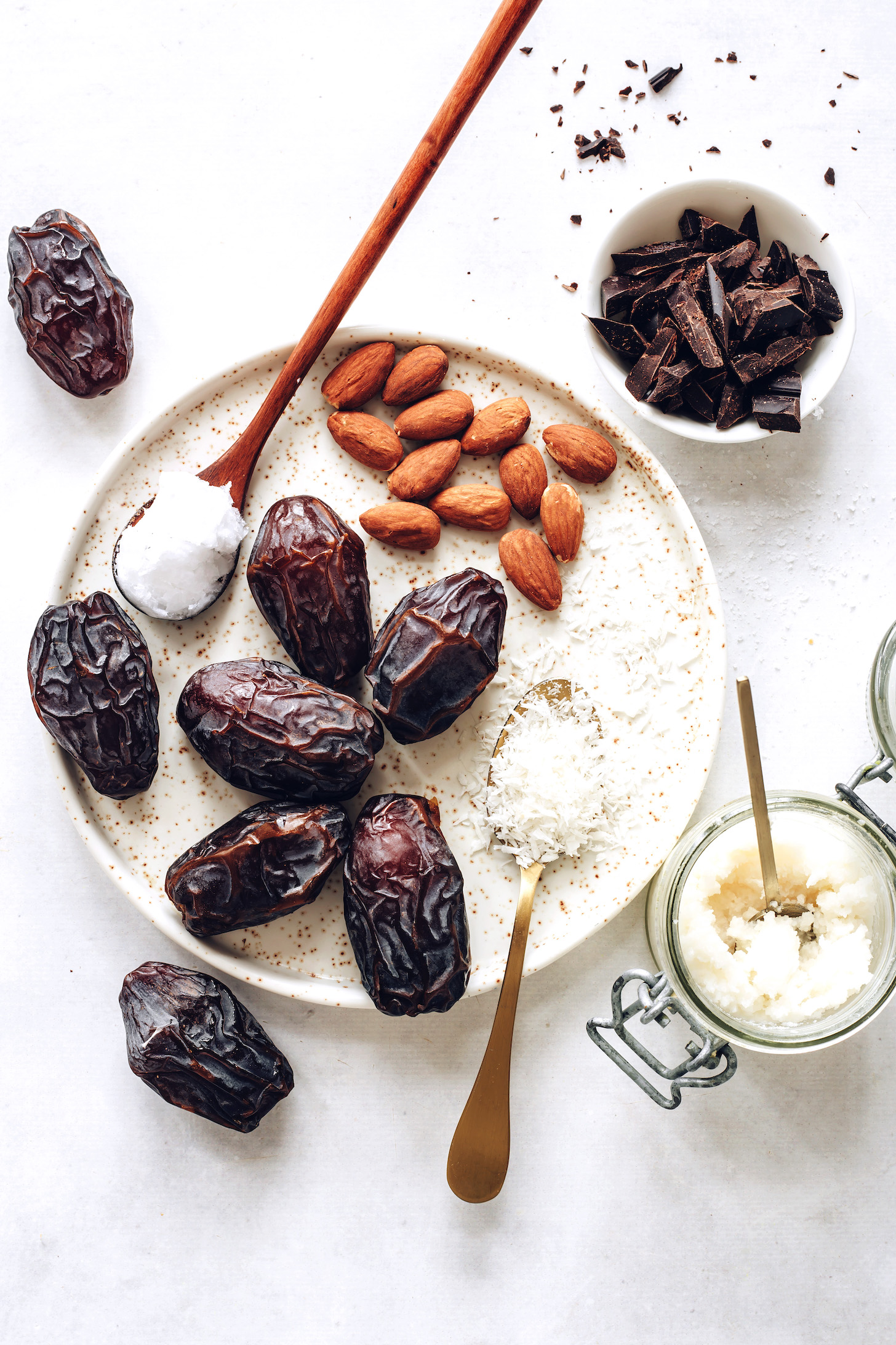 Medjool dates, coconut butter, desiccated coconut, almonds, coconut oil, and dark chocolate
