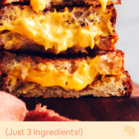 Stack of three vegan grilled cheese sandwiches