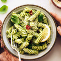 Vintage fork in a bowl of our avocado pesto pasta salad recipe
