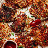 The best homemade hash browns topped with parsley and with a side of ketchup