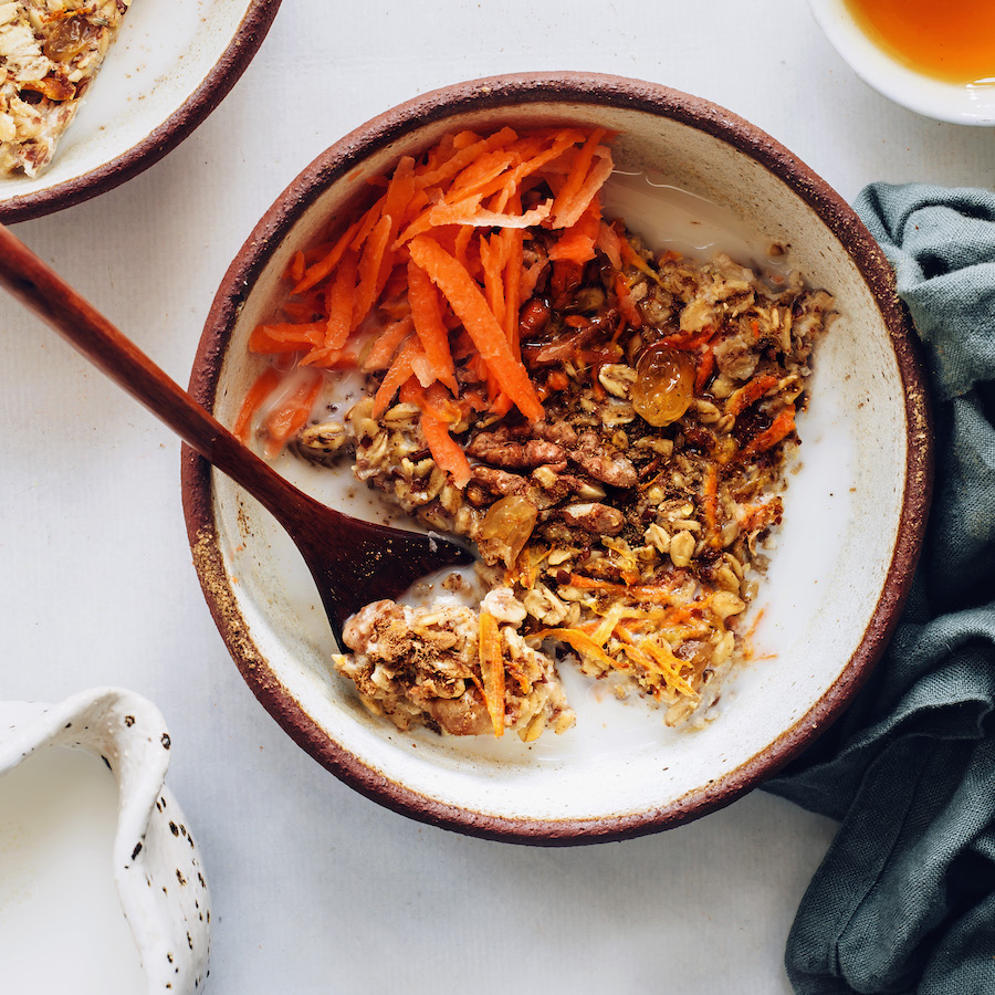 Bowl of carrot cake baked oatmeal topped with shredded carrots
