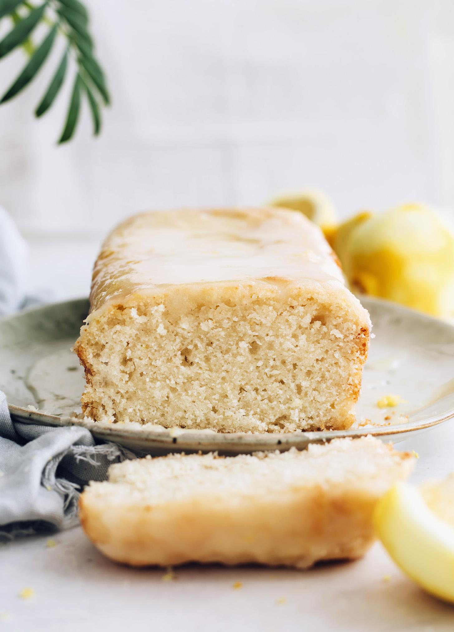 Partially sliced loaf of vegan lemon cake
