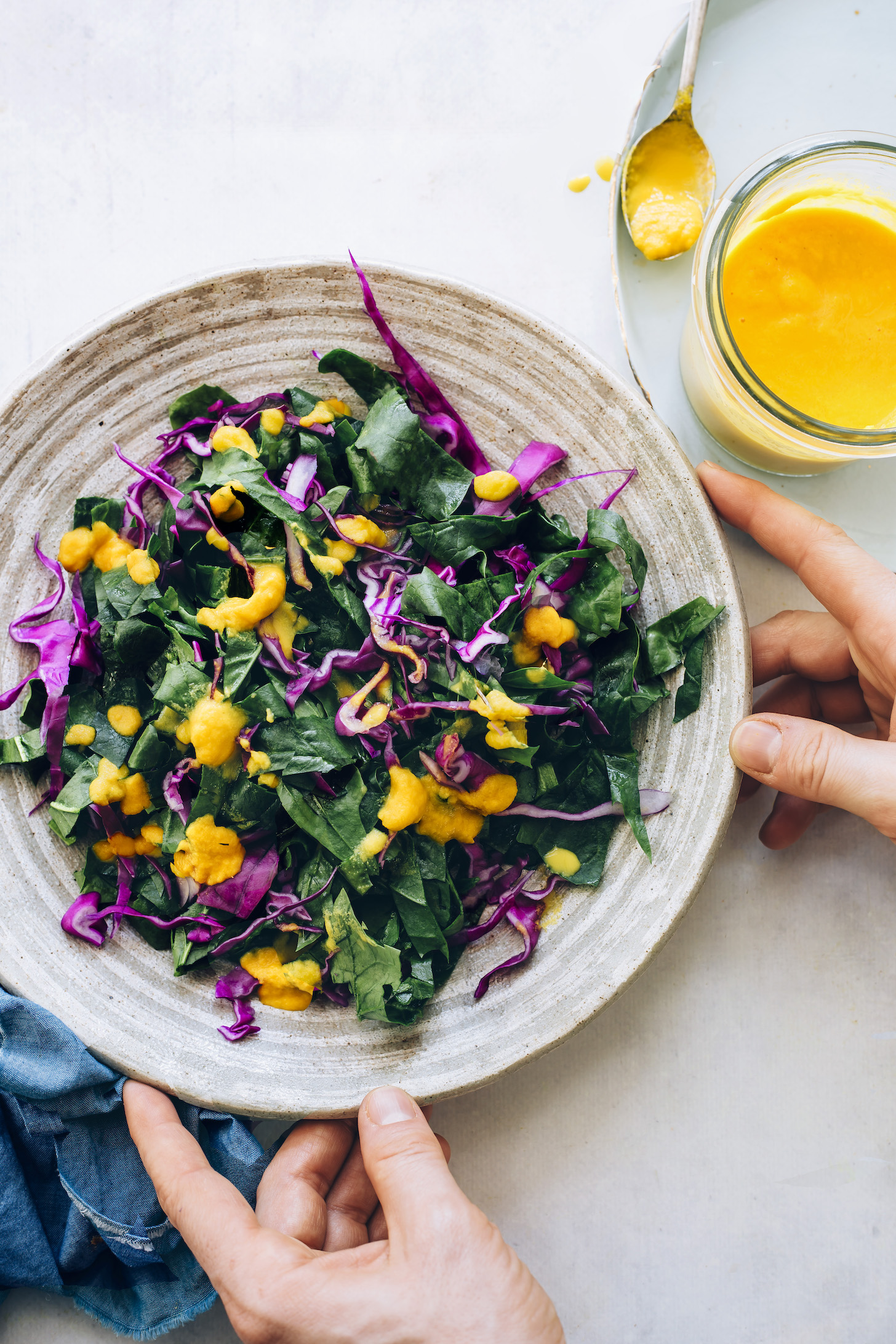 Kale and cabbage topped with carrot ginger dressing