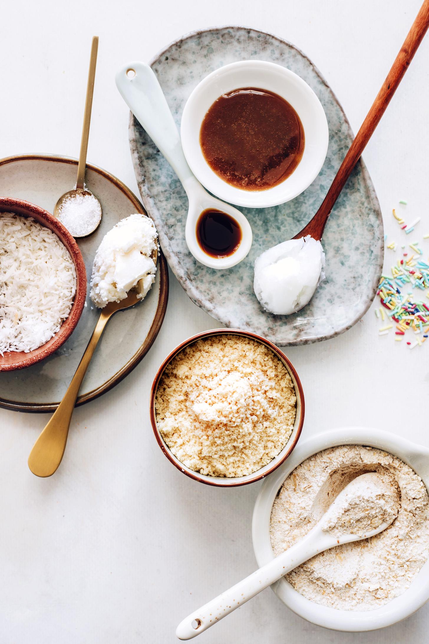 Oat flour, almond flour, sea salt, coconut oil, maple syrup, vanilla, coconut butter, coconut oil, shredded coconut, and sprinkles