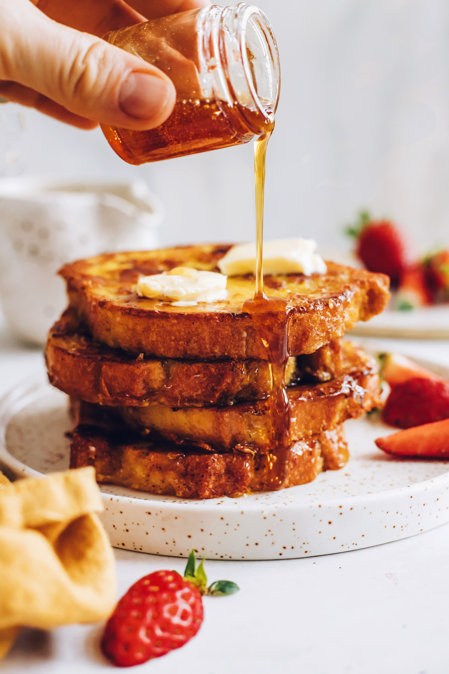 Maple syrup being drizzled over vegan French toast