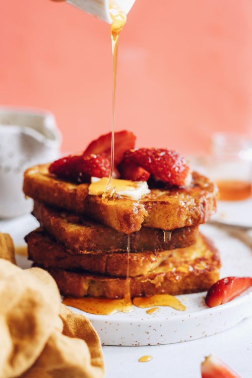 Drizzling syrup over sliced of vegan French toast