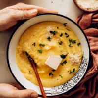 Holding the sides of a bowl of vegan polenta