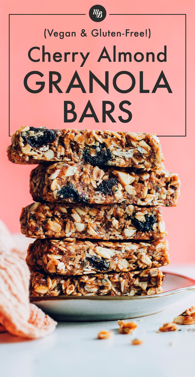 Cherry almond granola bars piled high on a plate