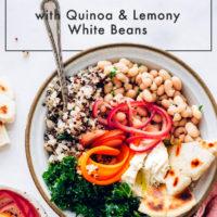 Spring Buddha bowl with quinoa, veggies, hummus, and gluten-free flatbread