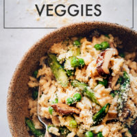Big bowl of vegan risotto with miso, asparagus, and mushrooms