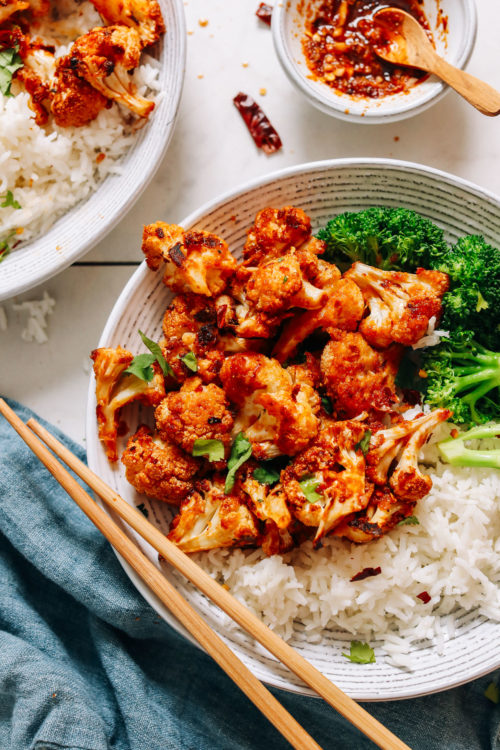 Bowl of General Tso Cauliflower with steamed broccoli and rice