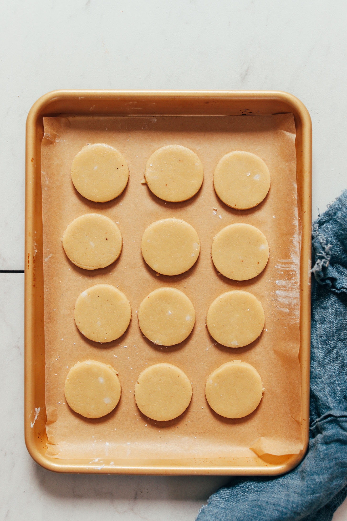 Unbaked shortbread cookie dough on a baking sheet