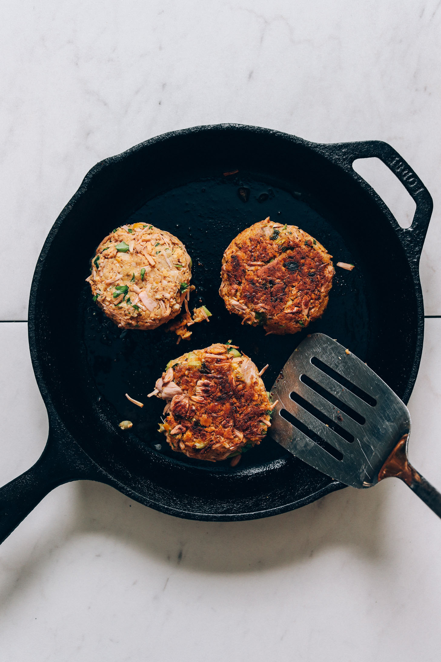 Cooking vegan crab cakes in a cast iron skillet