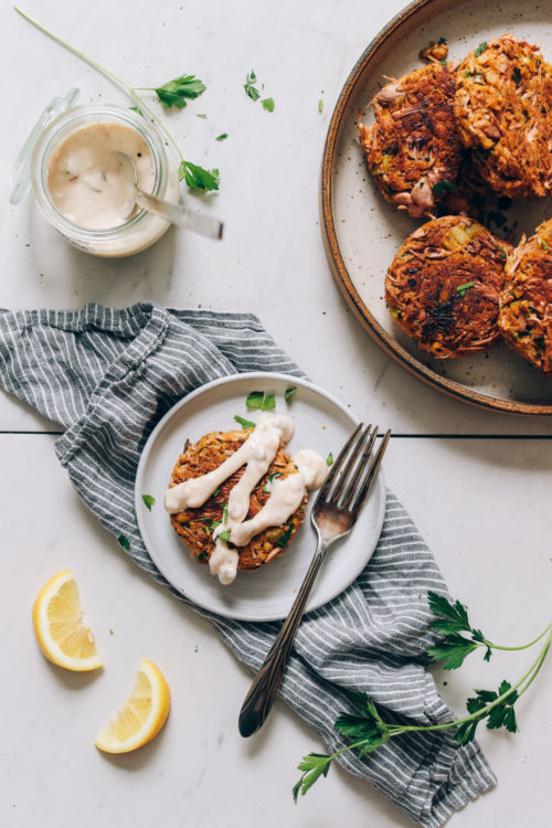 Plate of vegan crab cakes and one on a separate plate with vegan tartar sauce