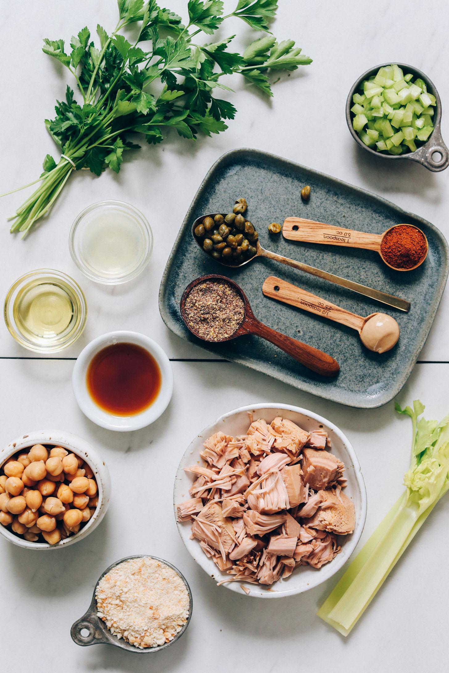 Parsley, celery, Old Bay seasoning, capers, mustard, flaxseed meal, avocado oil, worcestershire, chickpeas, breadcrumbs, jackfruit, and celery