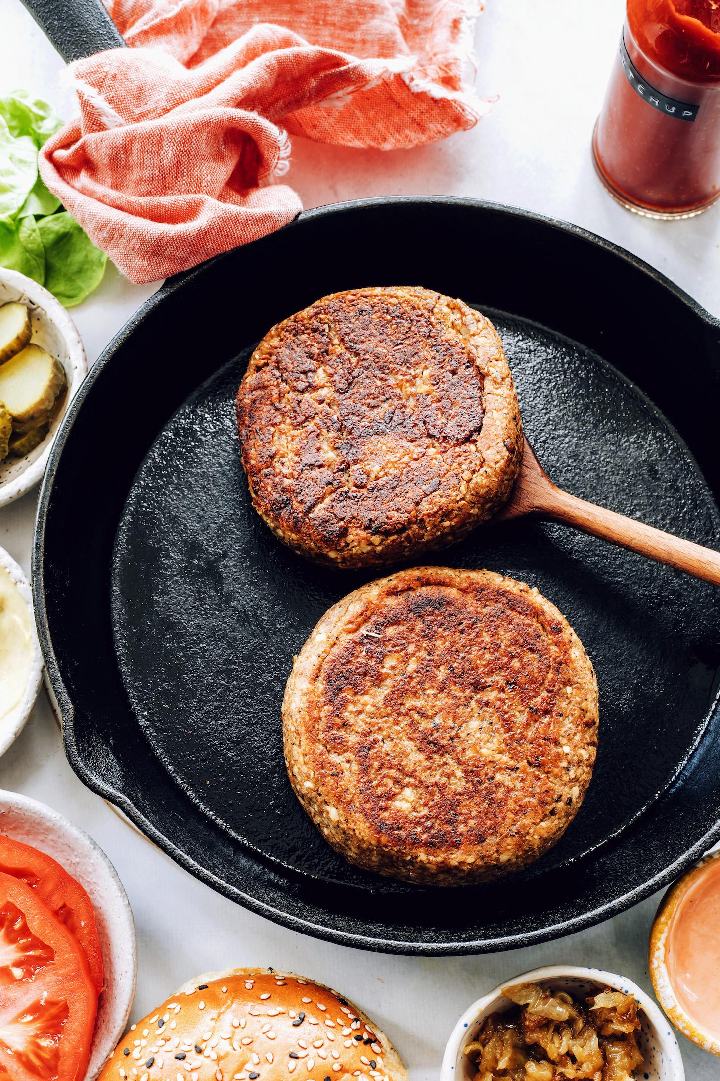 Cooking gluten-free vegan burger patties in a cast iron skillet