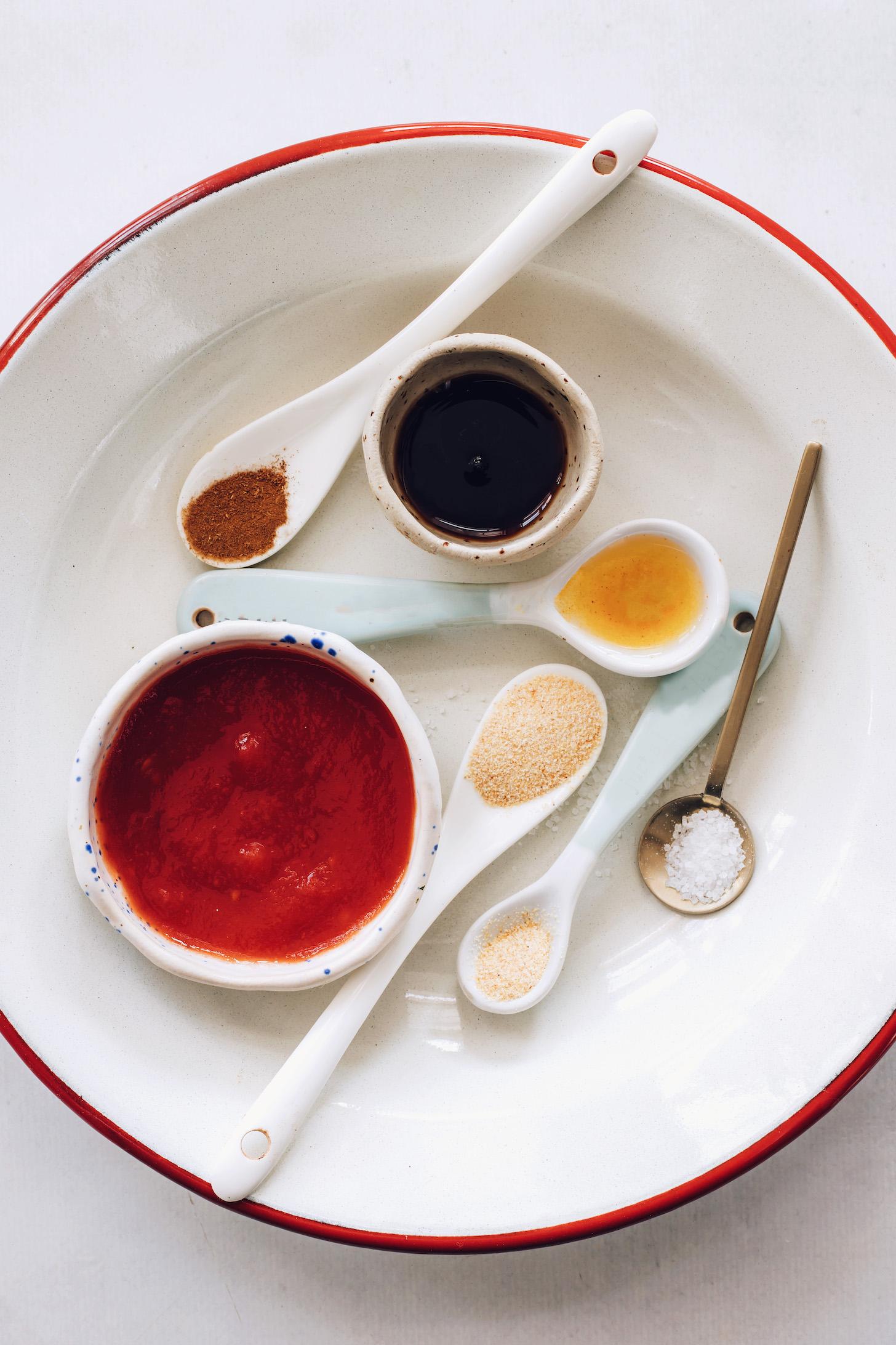 Tomato purée, garlic powder, onion powder, salt, vinegar, maple syrup, and allspice