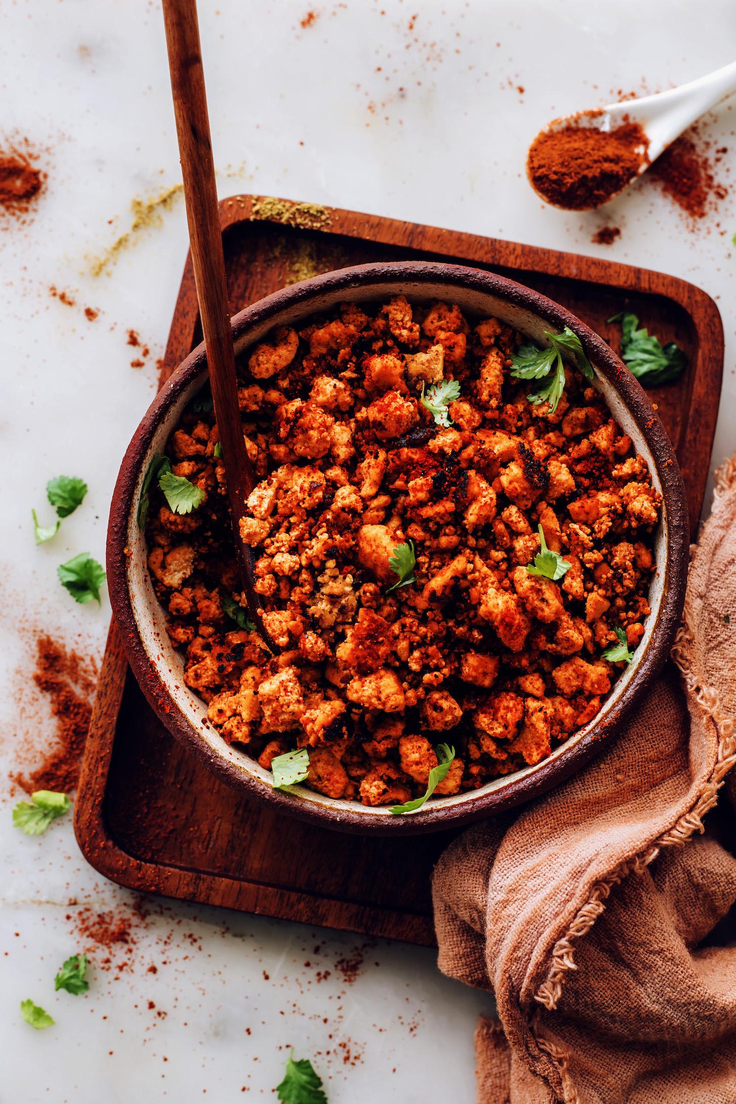 Bowl of crispy vegan chorizo sausage sprinkled with fresh cilantro