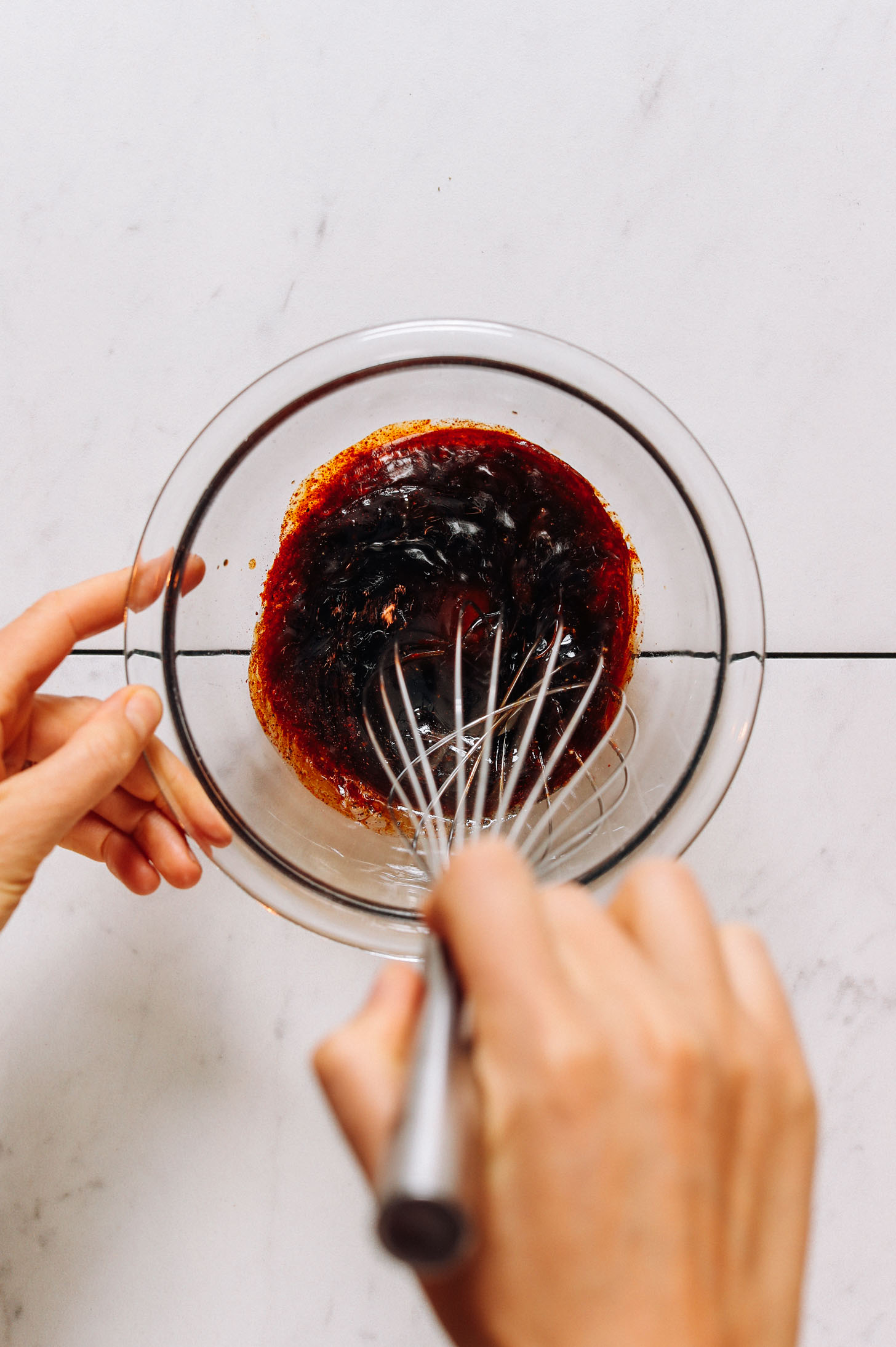 Whisking a marinade for tempeh bacon