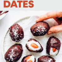 Picking up an almond joy stuffed date from a plate