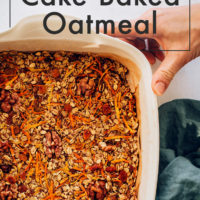 Hands holding a pan of Carrot Cake Baked Oatmeal