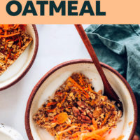 Bowl with a square of Carrot Cake Baked Oatmeal, shredded carrots, and dairy-free milk