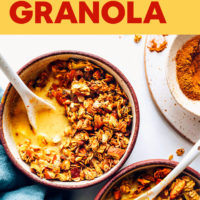 Bowl of Vegan Golden Milk Granola with almond milk and spices