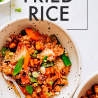 Bowls of Kimchi Fried Rice with snap peas and carrots