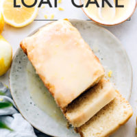 Slices of vegan and gluten-free lemon loaf cake on a plate with lemon icing