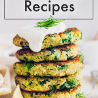Zucchini quinoa fritters on a plate with fresh dill