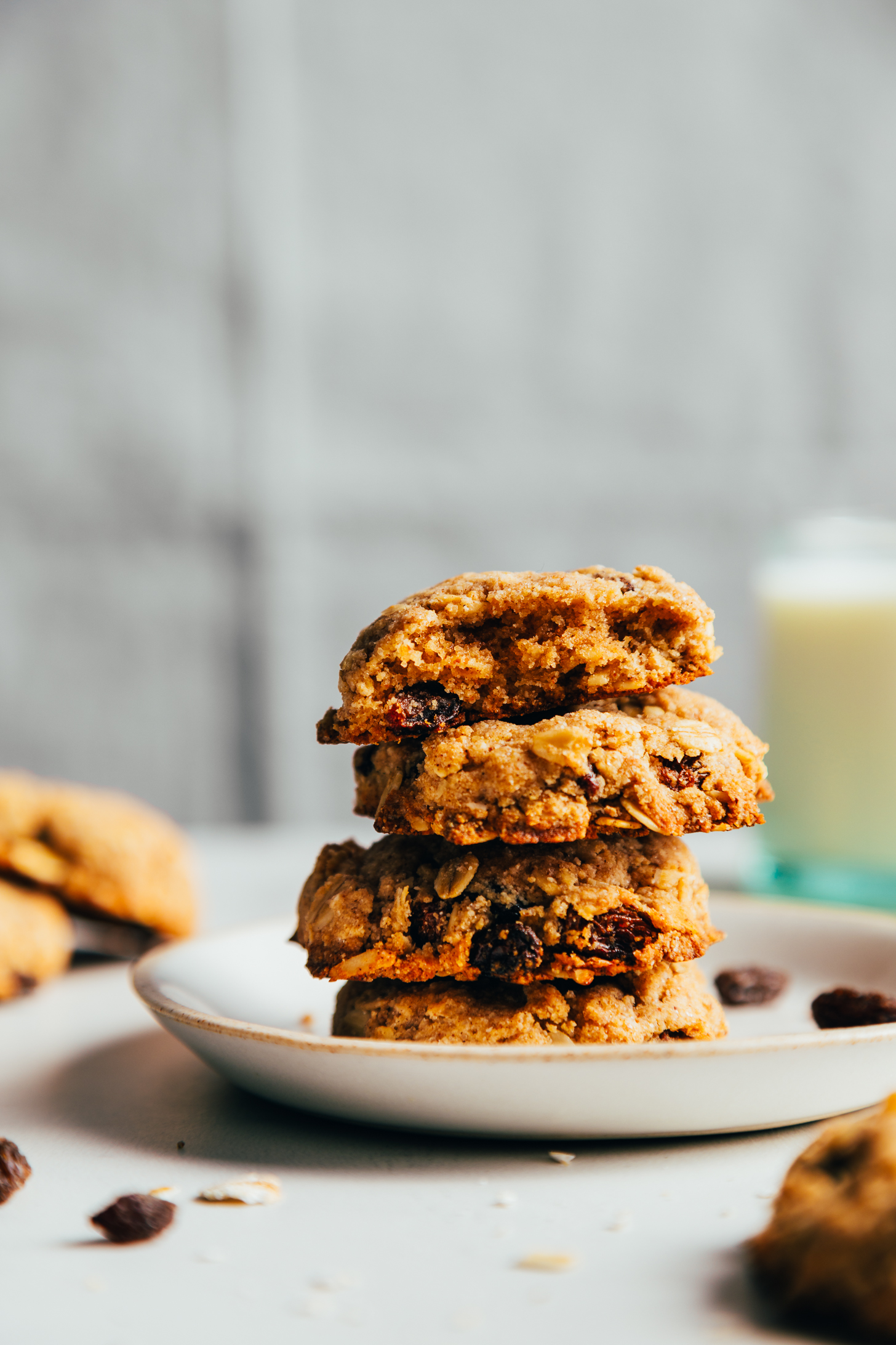 Stack of vegan oatmeal raisin cookies on a plate